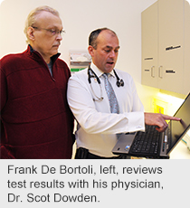 Frank De Bortoli, left, reviews test results with his physician, Dr. Scot Dowden.