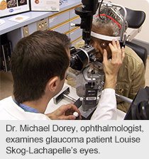 Dr. Michael Dorey, ophthalmologist, examines glaucoma patient Louise Skog-Lachapelle's eyes.