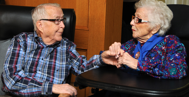 Marshall Bye enjoys some quality time with his wife of 60 years, Evelyn, in her Calgary long-term care facility.