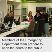 Members of the Emergency Department team prepare to open the doors to the public.