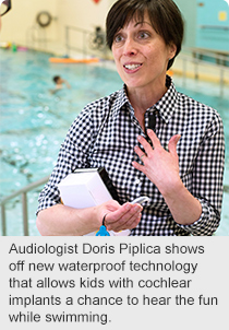 Audiologist Doris Piplica shows off new waterproof technology that allows kids with cochlear implants a chance to hear the fun while swimming