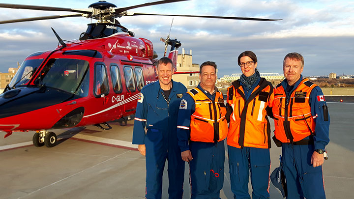 Dr. Anna Fuezery (middle) with STARS Air Ambulance pilots and medical flight crew.