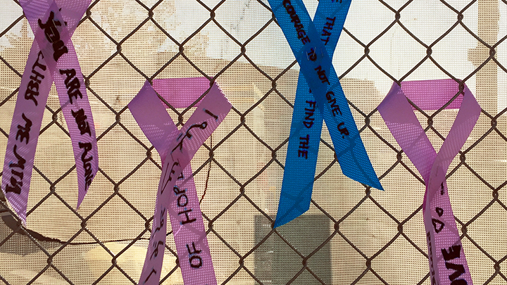 A few of the inspirational ribbons — each adorned with messages of love and hope — hang on the construction fence at the new Calgary Cancer Centre.