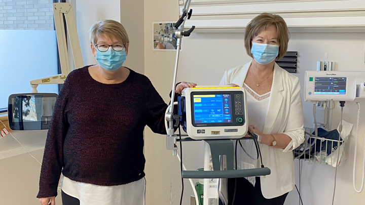 Valerie Messmer, president of Barrhead Healthcare Centre Auxiliary, and Linda Wolfram, site manager, pose with some of the equipment the auxiliary has helped buy, including a ventilator and bedside vital-sign monitor.