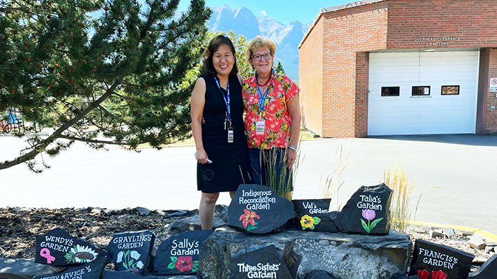 Volunteers Michiko Ellis, left, Rose Chobaniuk hand-painted each sign for the Canmore Hospital Gardens.