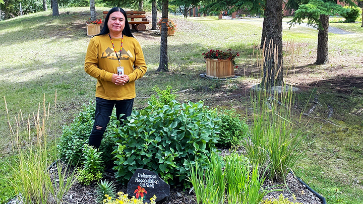 Kenny Hunter, an Indigenous liaison at Canmore General Hospital, visits the Indigenous Reconciliation Garden.