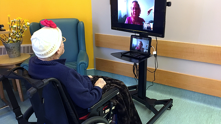 """Priscilla McQueen enjoys a virtual visit with her daughter Sheila Bolduc at Willow Creek Continuing Care Centre. """"I feel joy. It gives me a warm feeling,"""" she says."""