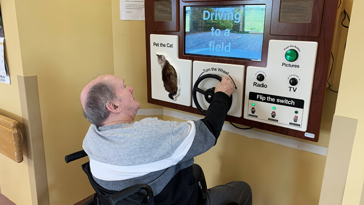 Resident Robert Smart enjoys a virtual drive on the ABBY system at Two Hills Hospital and Care Centre.