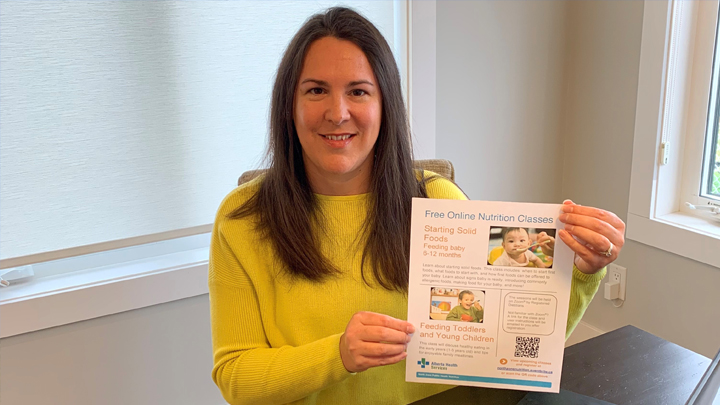 Jillyan Jay, a Registered Dietitian with North Zone Nutrition Services, holds a poster on two nutrition classes: Starting Solid Foods – Feeding your Baby (6-12 months) and Feeding Toddlers and Young Children – Tips for enjoyable mealtimes. The classes are held monthly for clients across the North Zone.