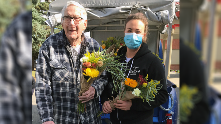 Mackenzie Place resident Cliff Sydbo chose a bouquet for himself and another for his wife from the Gypsy Blooms Flower Truck with the help of rehab therapist Drew Finnson in Grande Prairie. DRL Mechanical sponsored the flower truck's visit to the long-term care facility to provide bouquets for all of the residents, while Maxwell Mariano of Lyons Production sponsored vases for each resident's bouquet.
