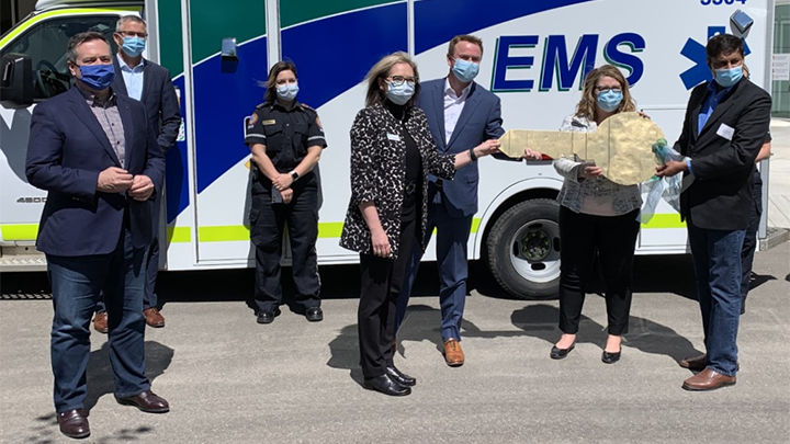 Senior Operating Officer Stacy Greening accepts the key to the new regional hospital in Grande Prairie from Health Minister Tyler Shandro, Grande Prairie MLA Tracy Allard and Infrastructure Minister Prasad Panda, while Premier Jason Kenney and Finance Minister Travis Toews look on.