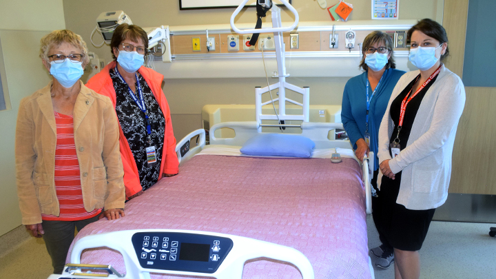 Standing alongside the new expandable double bed for palliative care at High Prairie Health Complex are, from left: Ione Perry, president, High Prairie Palliative Care Society; Margaret Kruger, president, High Prairie Ladies Health Care Auxiliary; Karen Zelman (AHS volunteer coordinator; and Samantha Nemec, care manager.