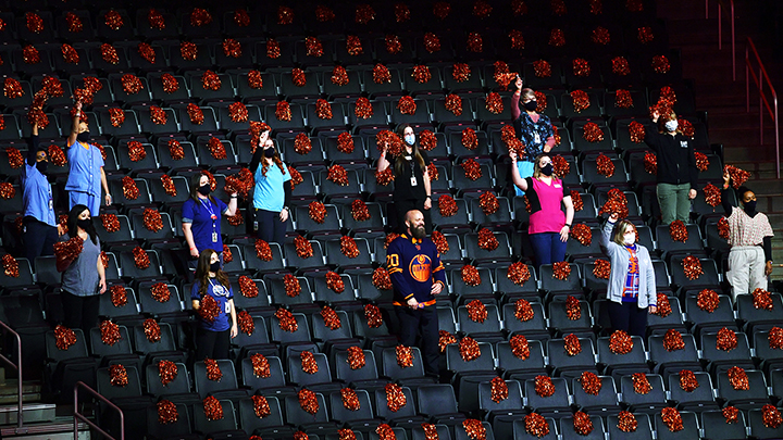 A dozen randomly-selected AHS frontline healthcare workers joined the Edmonton Oilers' anthem singer in the stands of Rogers Place to watch the May 12 NHL playoff game against the Winnipeg Jets.