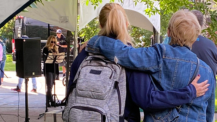 Family members share a hug in memory of loved ones lost to drug use at an Overdose Awareness Day event hosted by the AHS Safeworks team at Central Memorial Park in downtown Calgary.