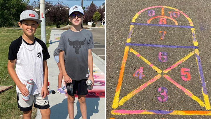 Channing Richer and Karsen Varty stencil games on Red Deer pathways as part of a youth initiative to spread kindness and build self-esteem.