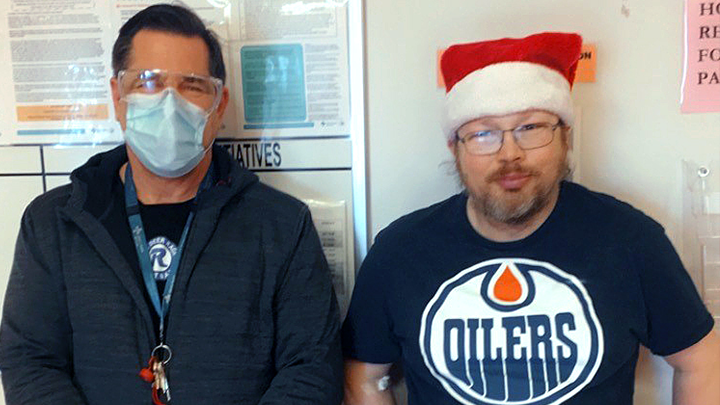 Alvin Cournoyer, right, a patient at Alberta Health Services' Centennial Centre for Mental Health and Brain Injury in Ponoka, is working with his aide Orion Donison so he can succeed in moving home and return to living a successful life.
