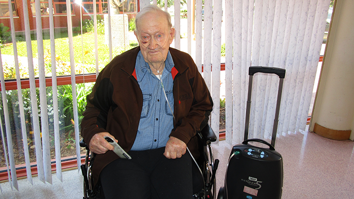 John Dahlseide, a resident at Cold Lake Long-Term Care Centre, enjoys using the new portable oxygen concentrator that was recently donated by the Cold Lake Healthcare Centre Auxiliary.