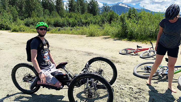 Respiratory therapist Matt MacKay rides an adaptive bike in Whistler, B.C., one year after suffering a traumatic spinal cord injury in a mountain-biking accident.