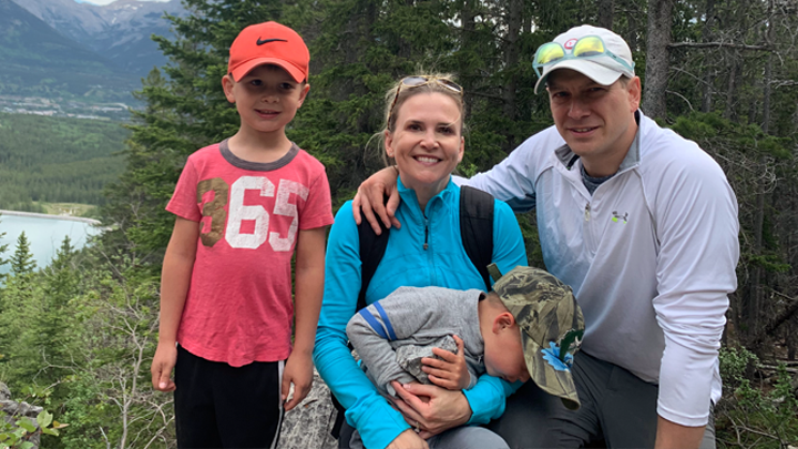 Dr. Corey Adams, right, a cardiac surgeon at Foothills Medical Centre, enjoys an outing with his family at Grassi Lakes. Adams administered lifesaving CPR on Darrell Parker at Grassi Lakes and then performed the man's bypass surgery just days later, saving Parker's life not once, but twice.
