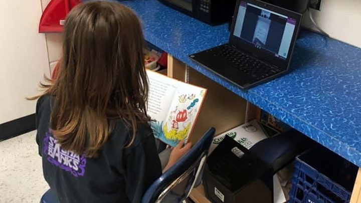 A student of E.G. Wahlstrom School in Slave lake reads virtually to a patient at Slave Lake Healthcare Centre as part of a special literacy partnership between the school and AHS.