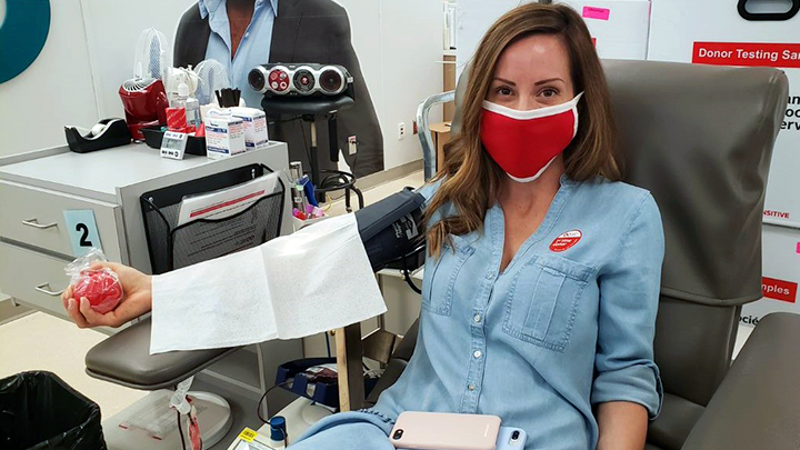 Stollery nurse Dena Chuckrey dons a face mask to donate blood for the first time. Chuckrey organized a group donation with her nursing colleagues in response to the blood shortage during the COVID-19 pandemic. Blood and blood products are integral to patients involved in major surgeries, medical procedures, cancer treatments and managing diseases and disorders.
