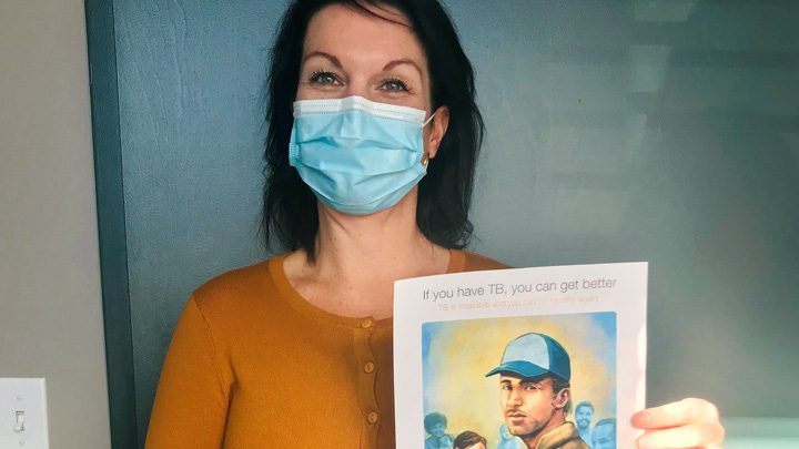 Jennifer Splaine, area manager for Fort McMurray Public Health, shows off one of four prevention-focused tuberculosis resources that are now available with Alberta Health Services. Public health developed them in partnership with AHS TB Services and AHS Communications and Community Engagement, and with in-kind funding and support from the University of Alberta's Tuberculosis Program Evaluation and Research Unit.